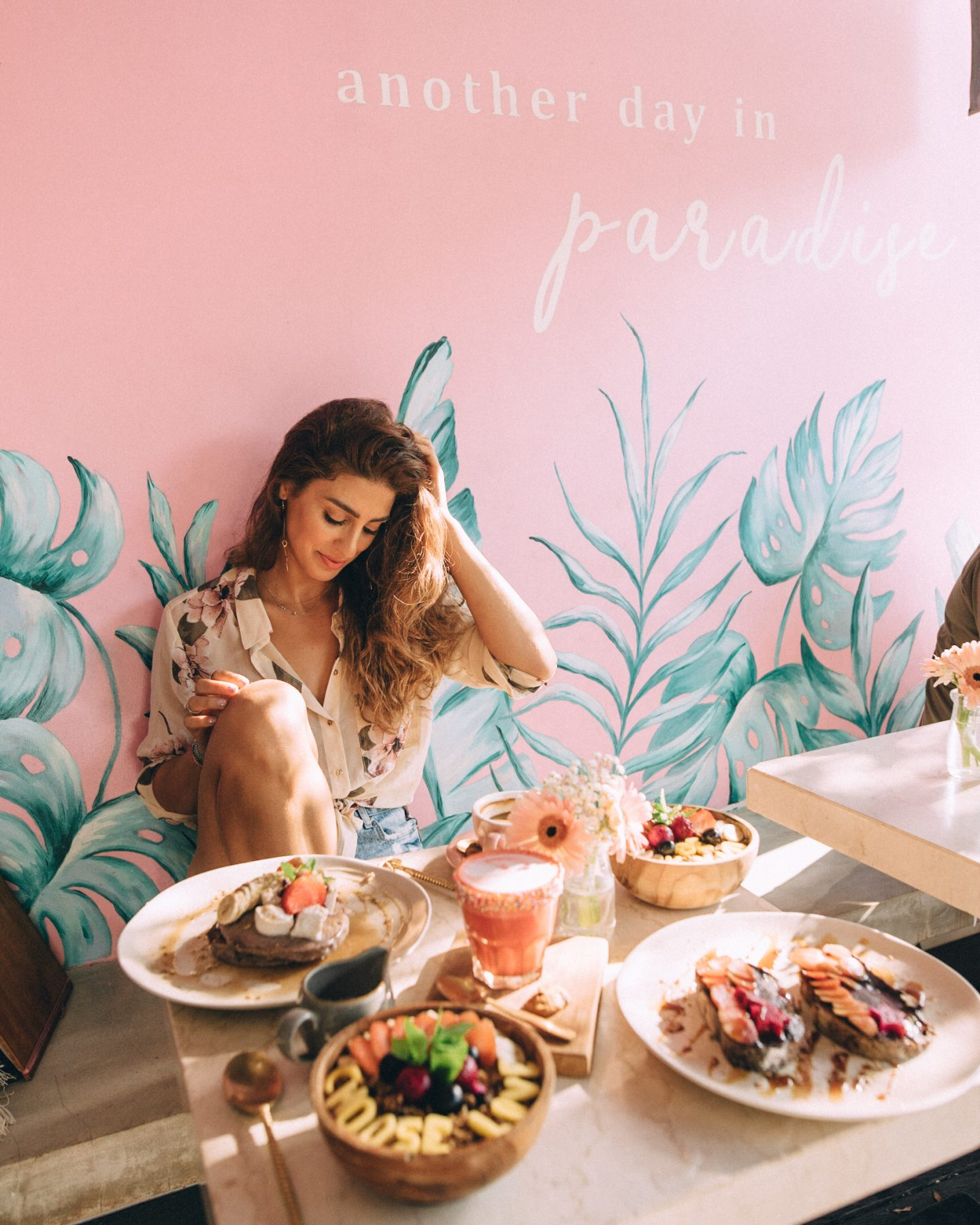 Woman eating in Kynd Cafe in Bali, one of the best cafes in Bali for Instagram photos