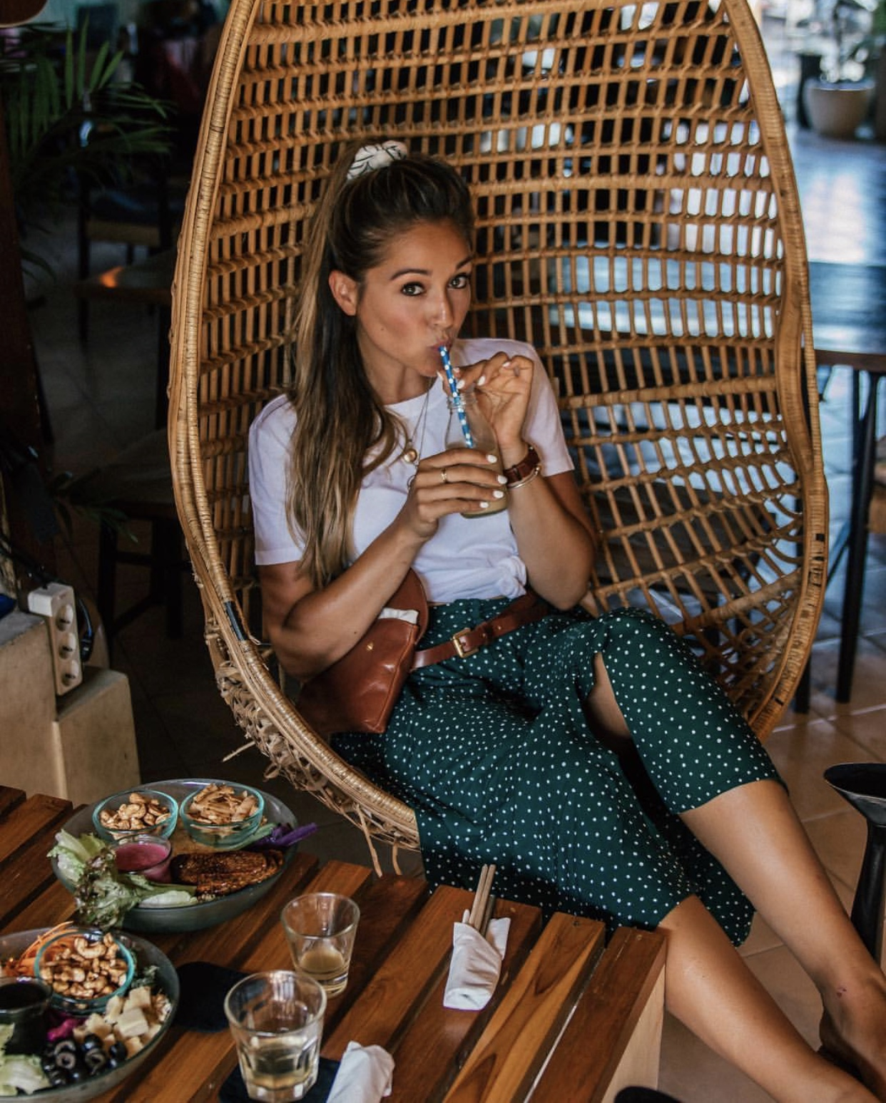 A woman enjoying a meal at Sayuri in Canggu, Bali