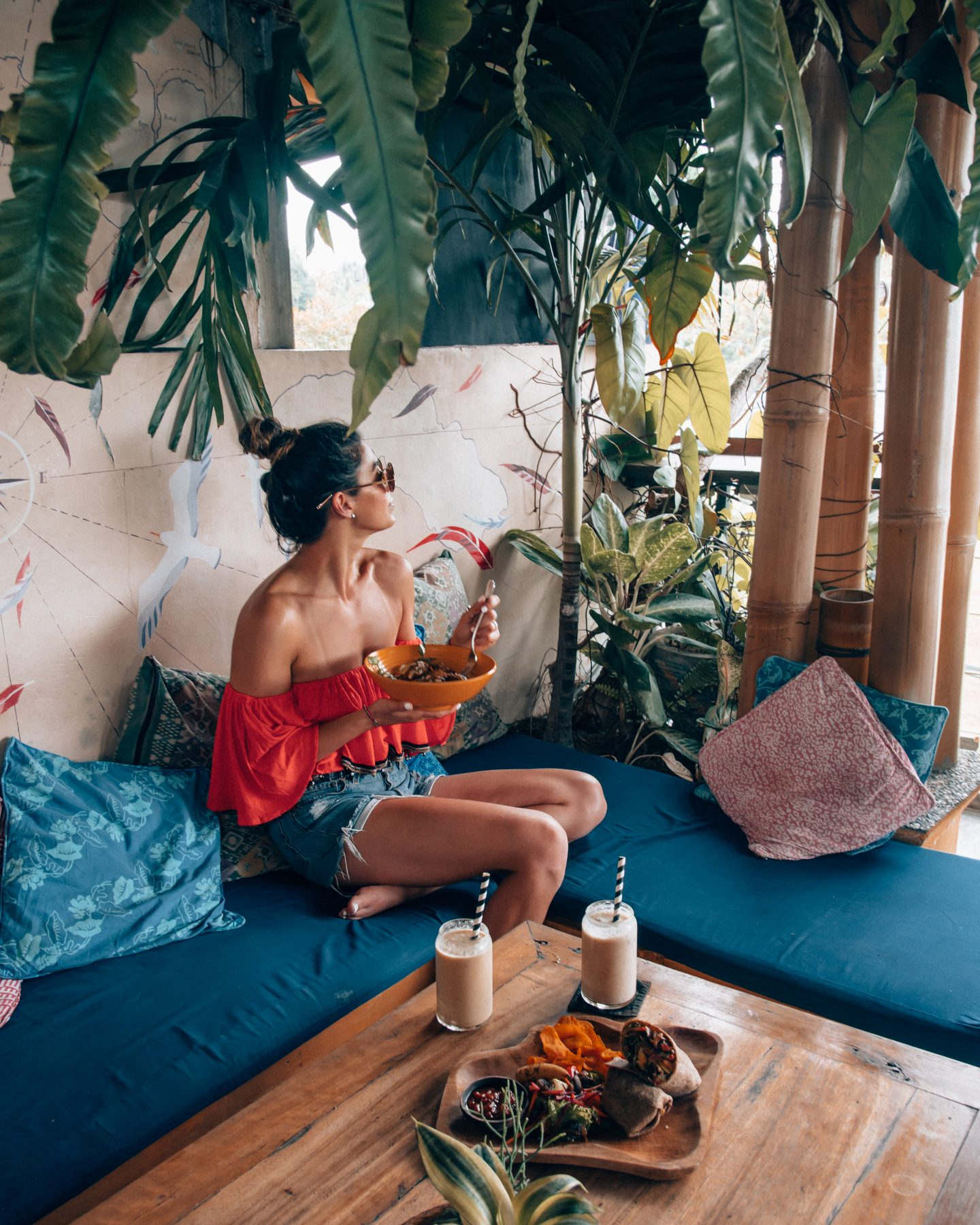 A woman eating in a cafe in Bali