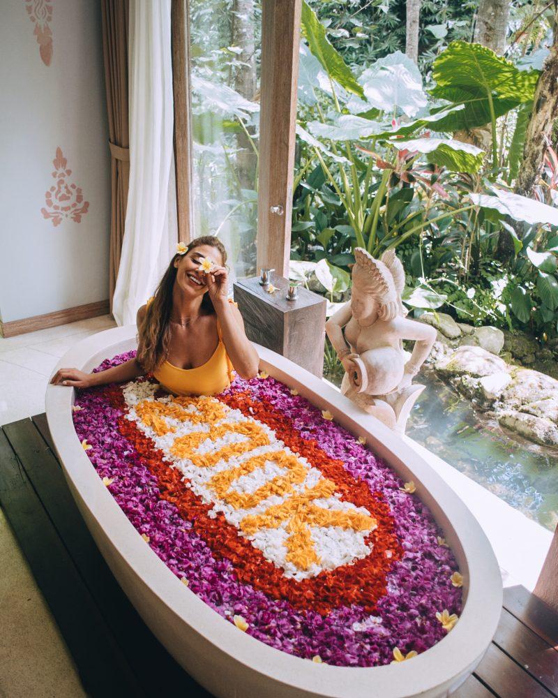 Lisa Homsy in a flower bath at the Udaya in Ubud, Bali