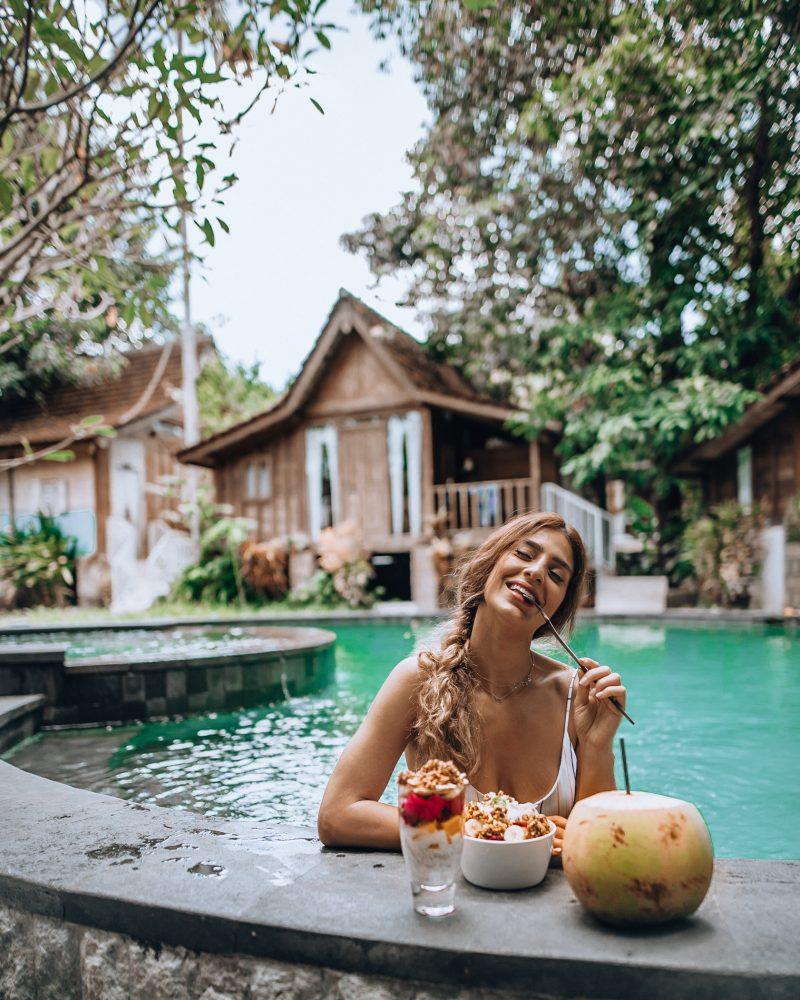 Lisa Homsy eating breakfast in a pool in Canggu Bali