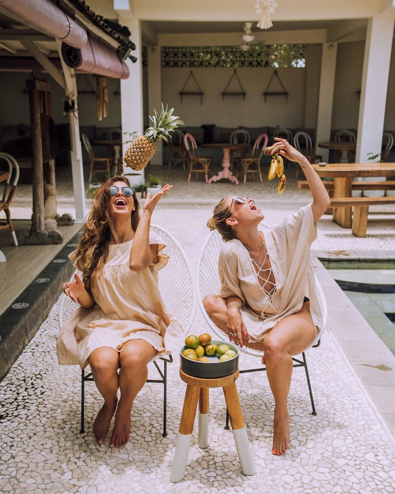 Two women relaxing by the pool at Chillhouse, one of the best hotels in Canggu Bali