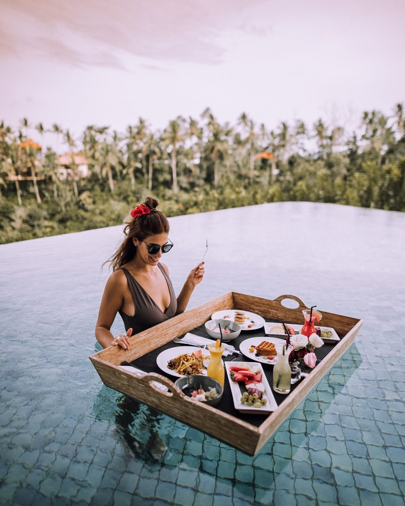 A woman eating a floating breakfast in Bali