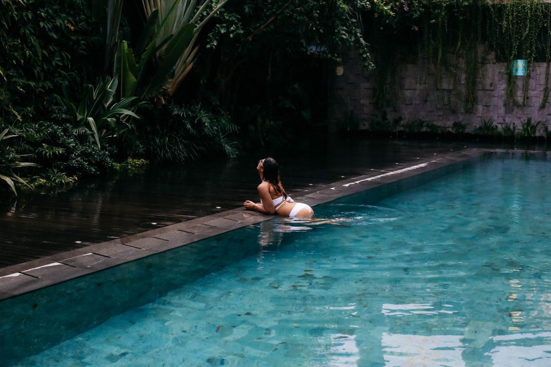 A woman in the pool at Tijili hotel in Seminyak, Bali.