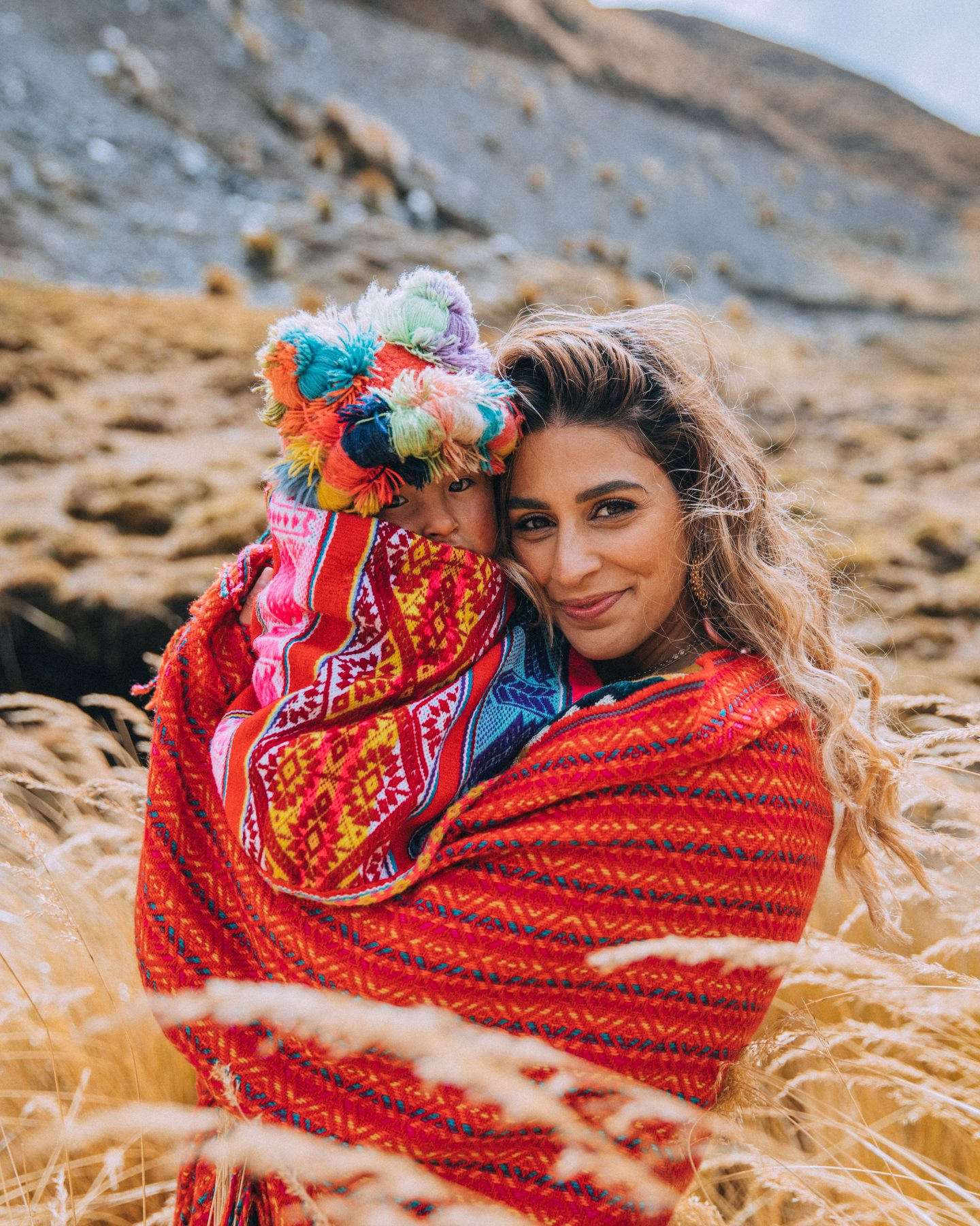 Girl holding Peruvian child