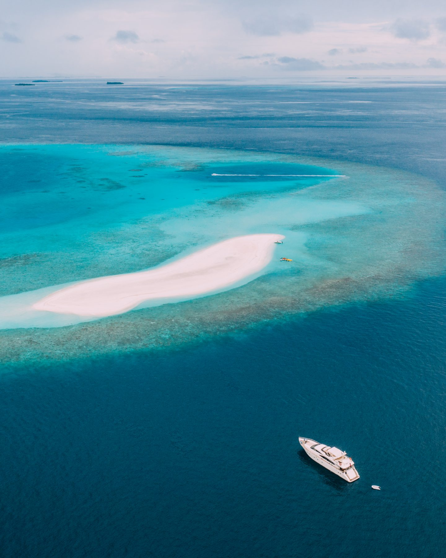 Aerial view of the Maldives and the luxury yacht