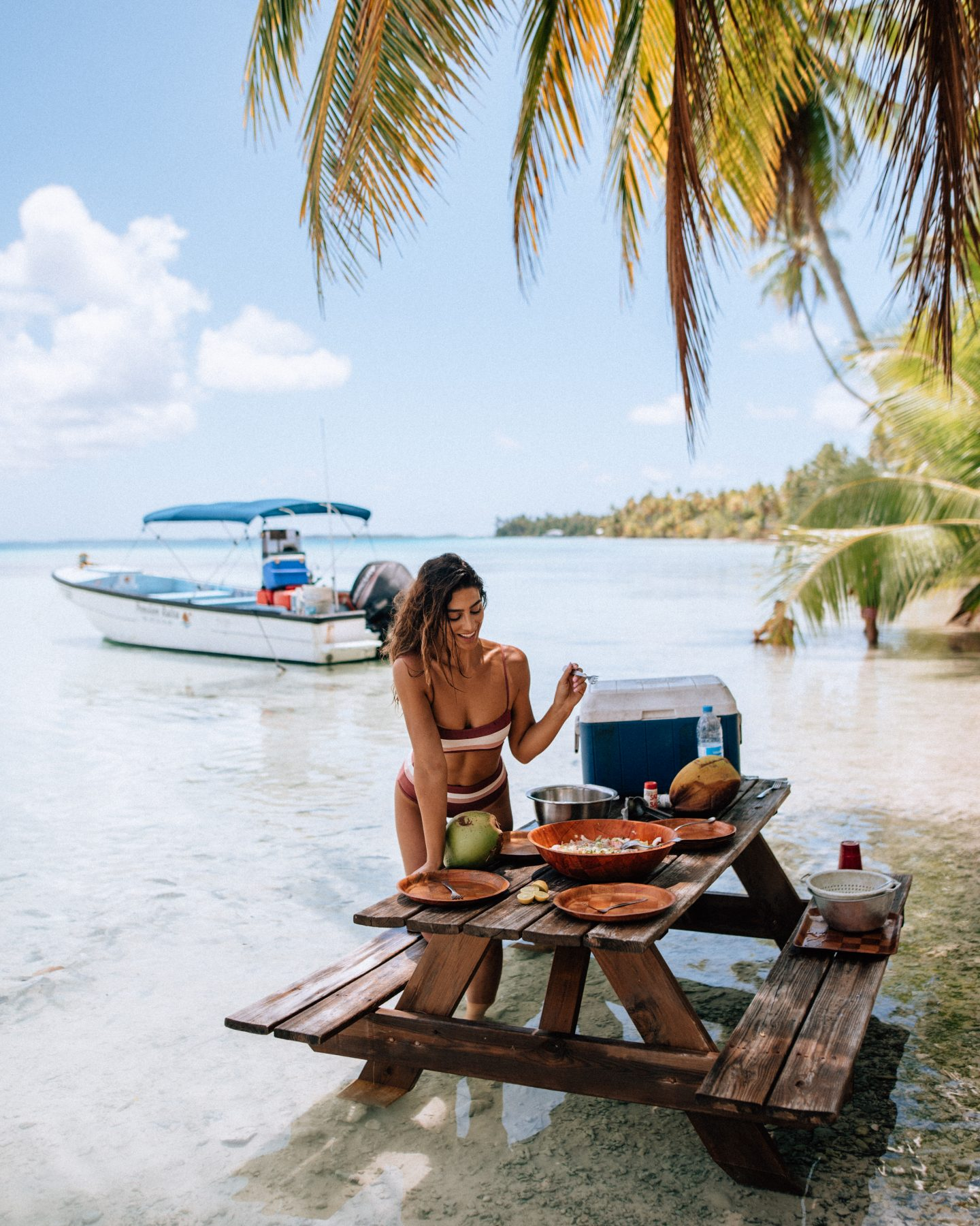 Lisa Homsy enjoying a picnic on an island in Tahiti