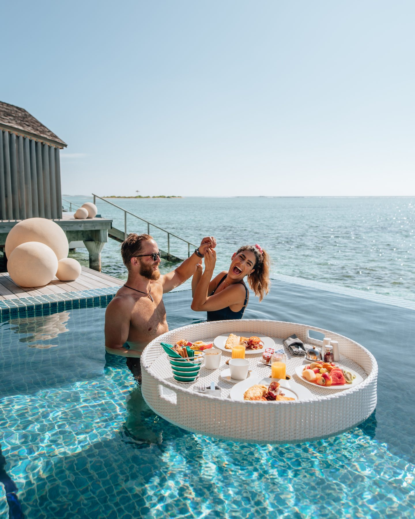 Enjoying a floating breakfast in the pool at Club Med Finolhu in the Madlives, an all-inclusive resort