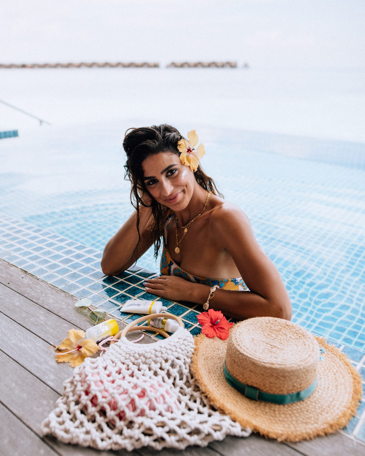 A woman in the pool at Club Med Finolhu