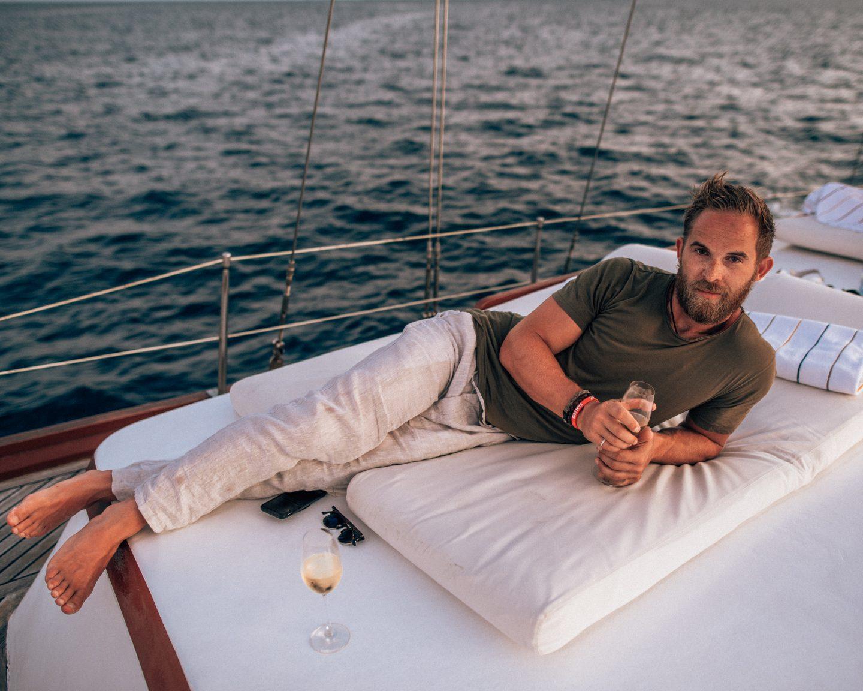 Man on sunset cruise with Conrad Rangali Island in the Maldives