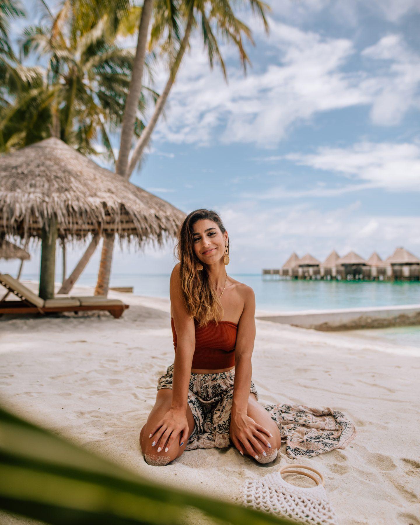 Woman on the beach at Club Med Finolhu