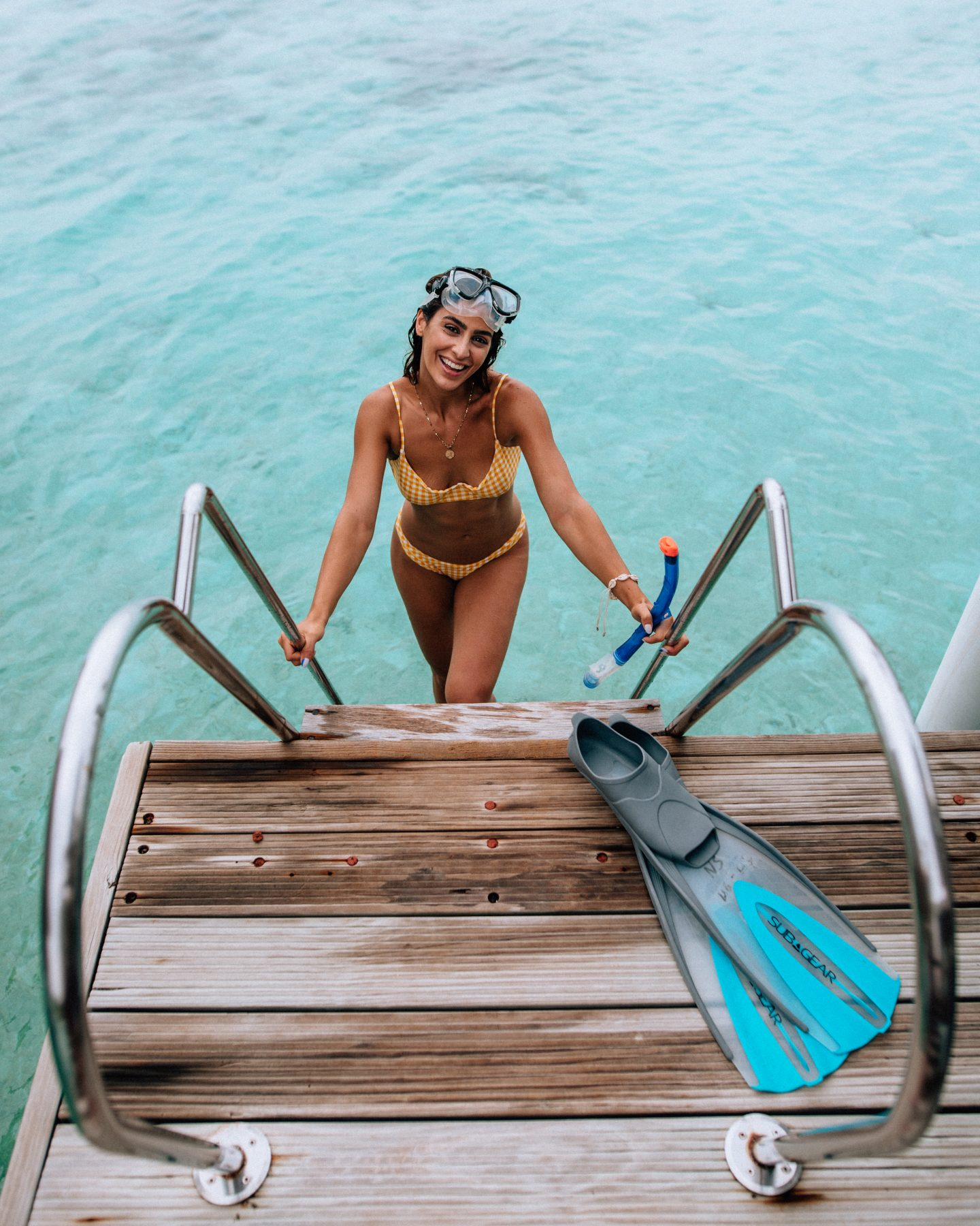 Woman coming back from swimming in the Maldives at Kandolhu