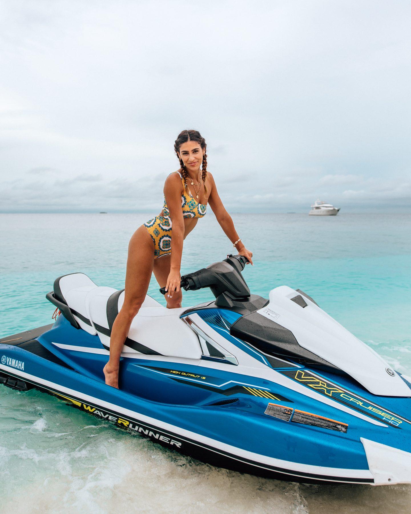 Woman on jetski in the Maldives
