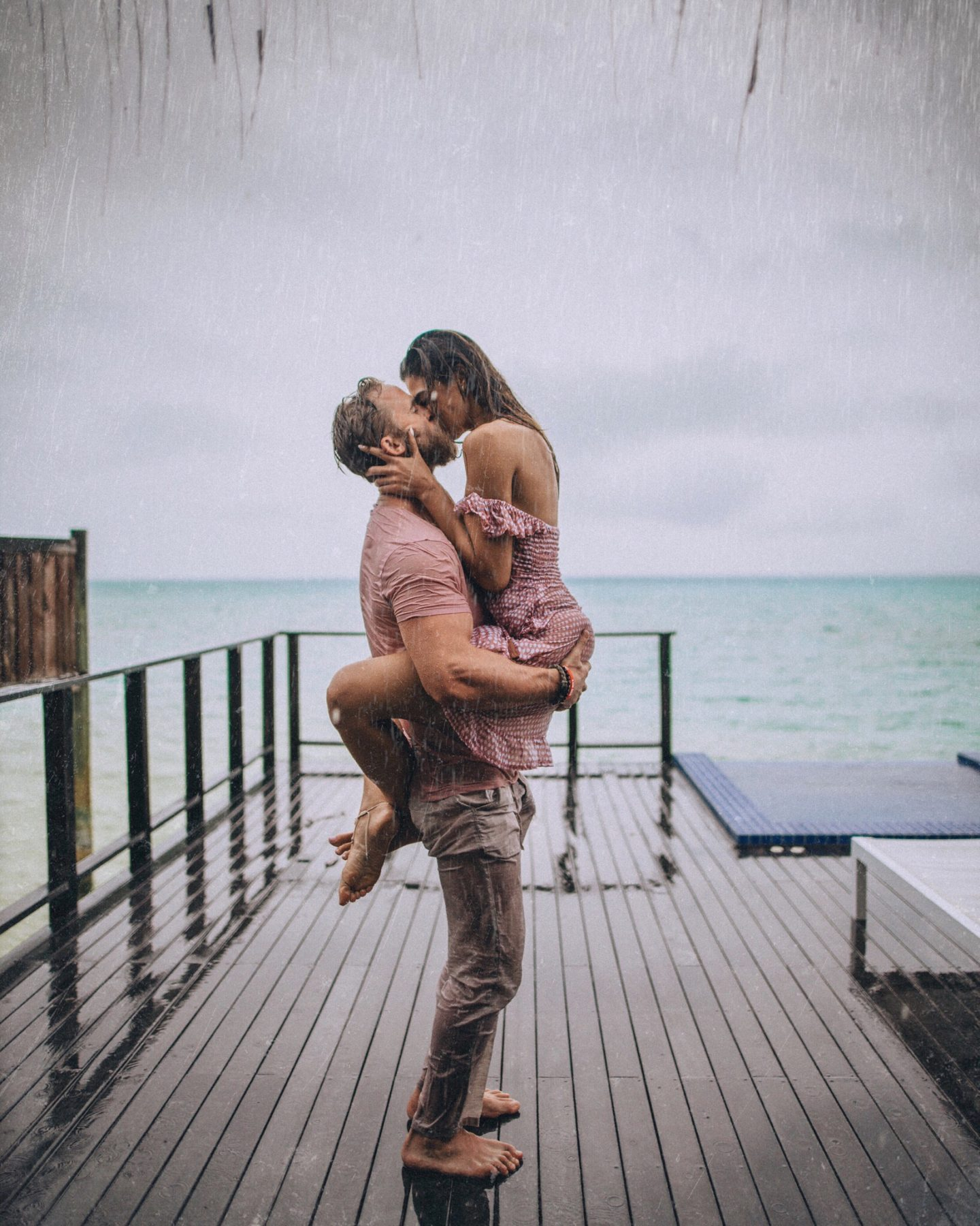 Couple reinacts the famous kiss from The Notebook in an overwater bungalow at Conrad Rangali Island in the Maldives