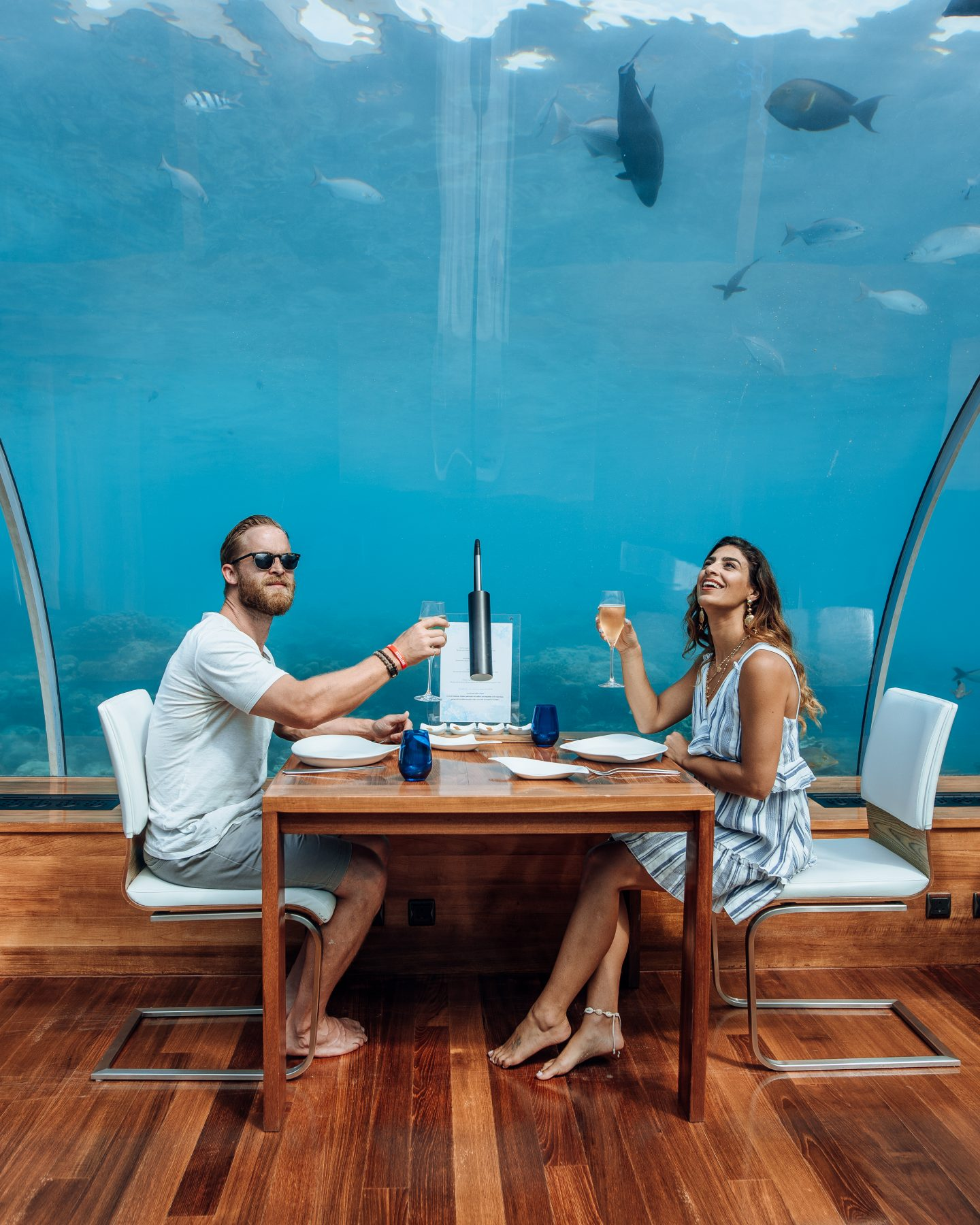 Couple dining in underwater restaurant at Conrad Rangali Island in the Maldives