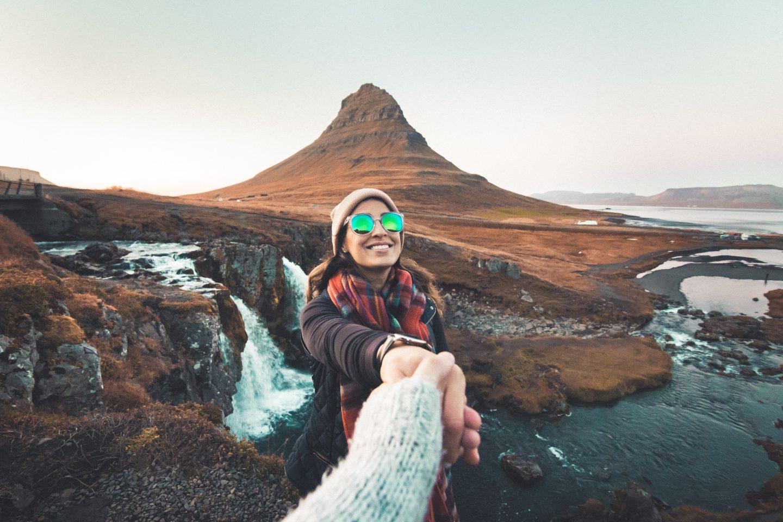 Woman in front of Kirkjufellsfoss in Iceland @lisahomsy