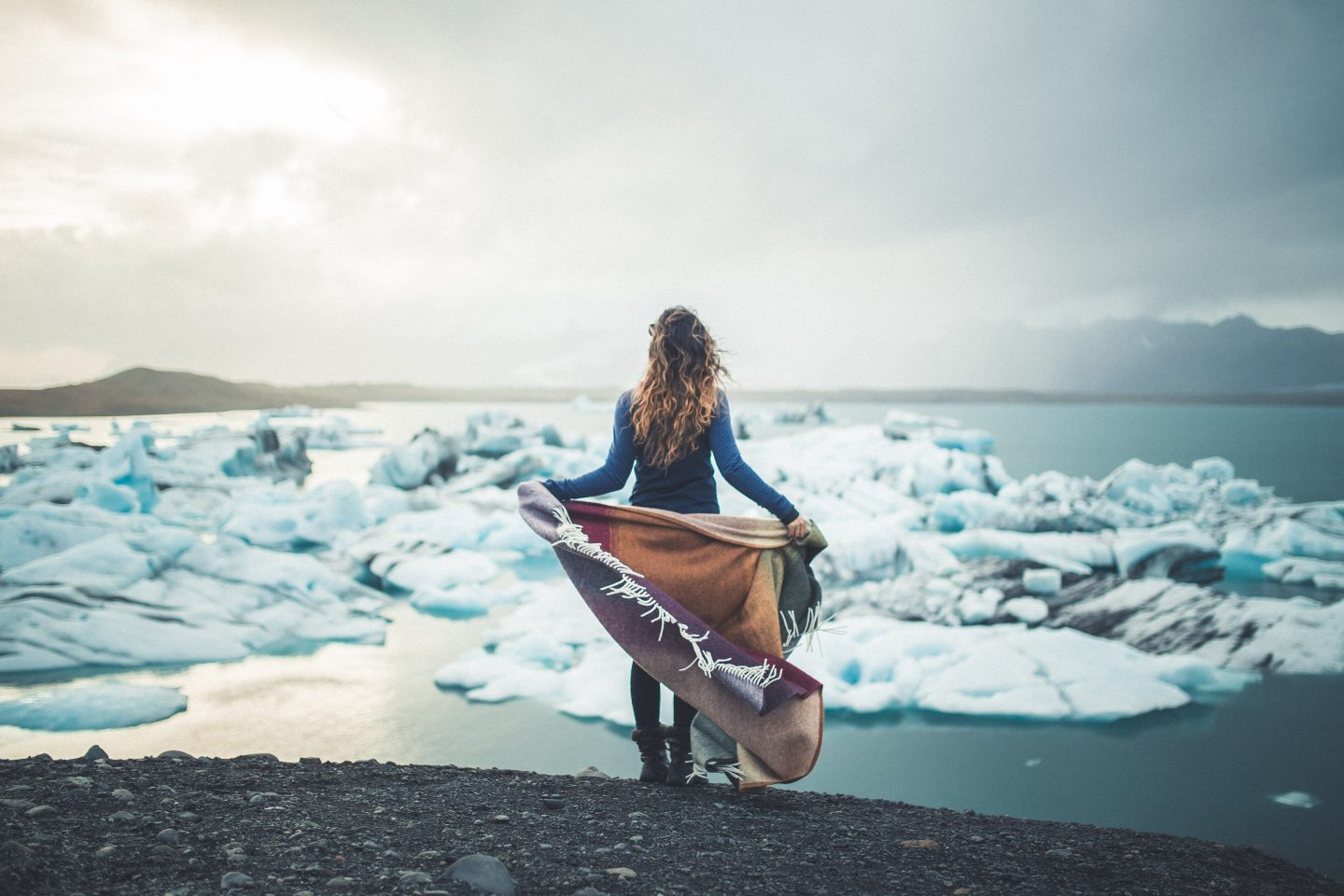 Woman at Jokulsarlon Glacier Lagoon in Iceland @lisahomsy