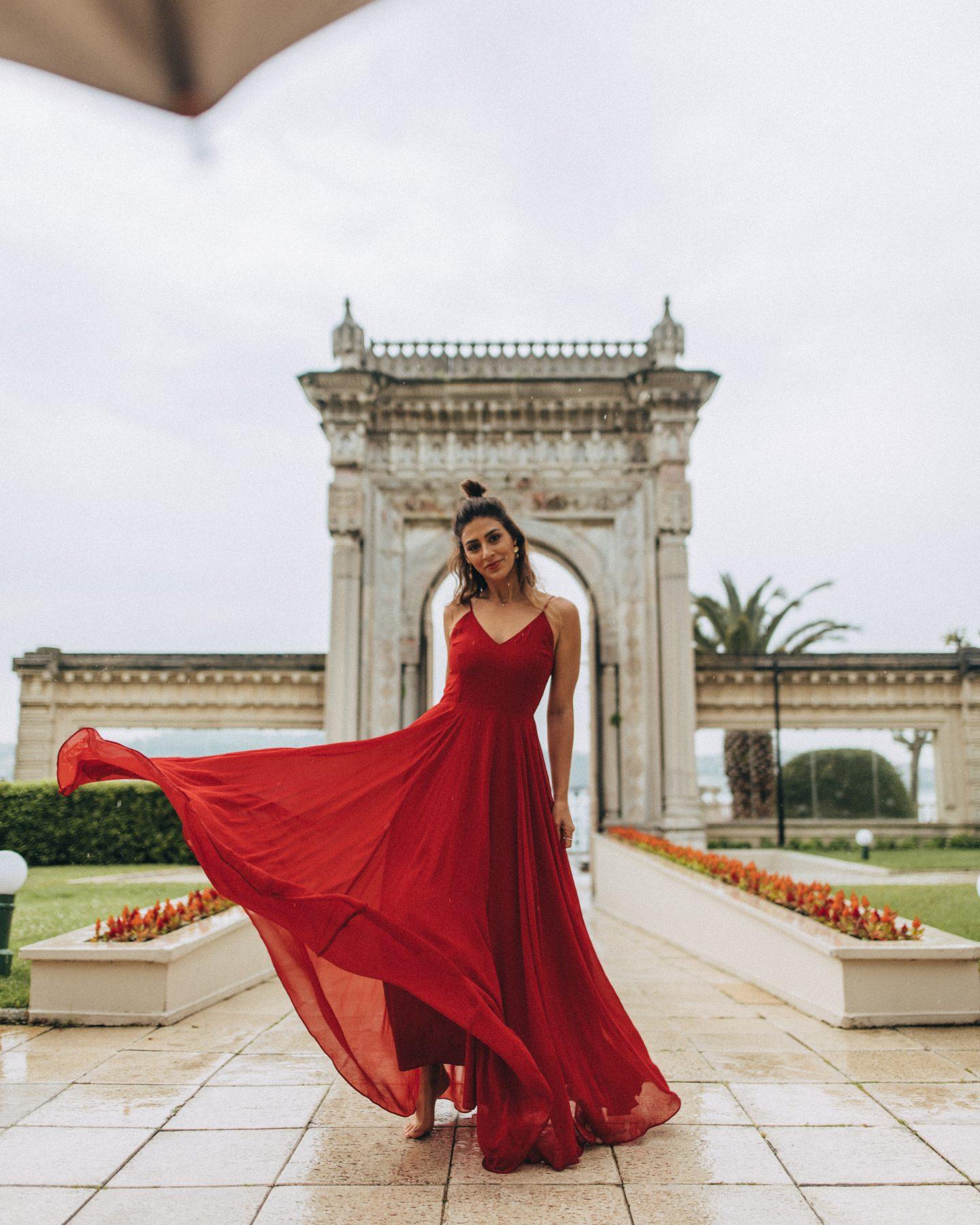 A woman twirls her dress at Ciragan Palace Kempinski Istanbul