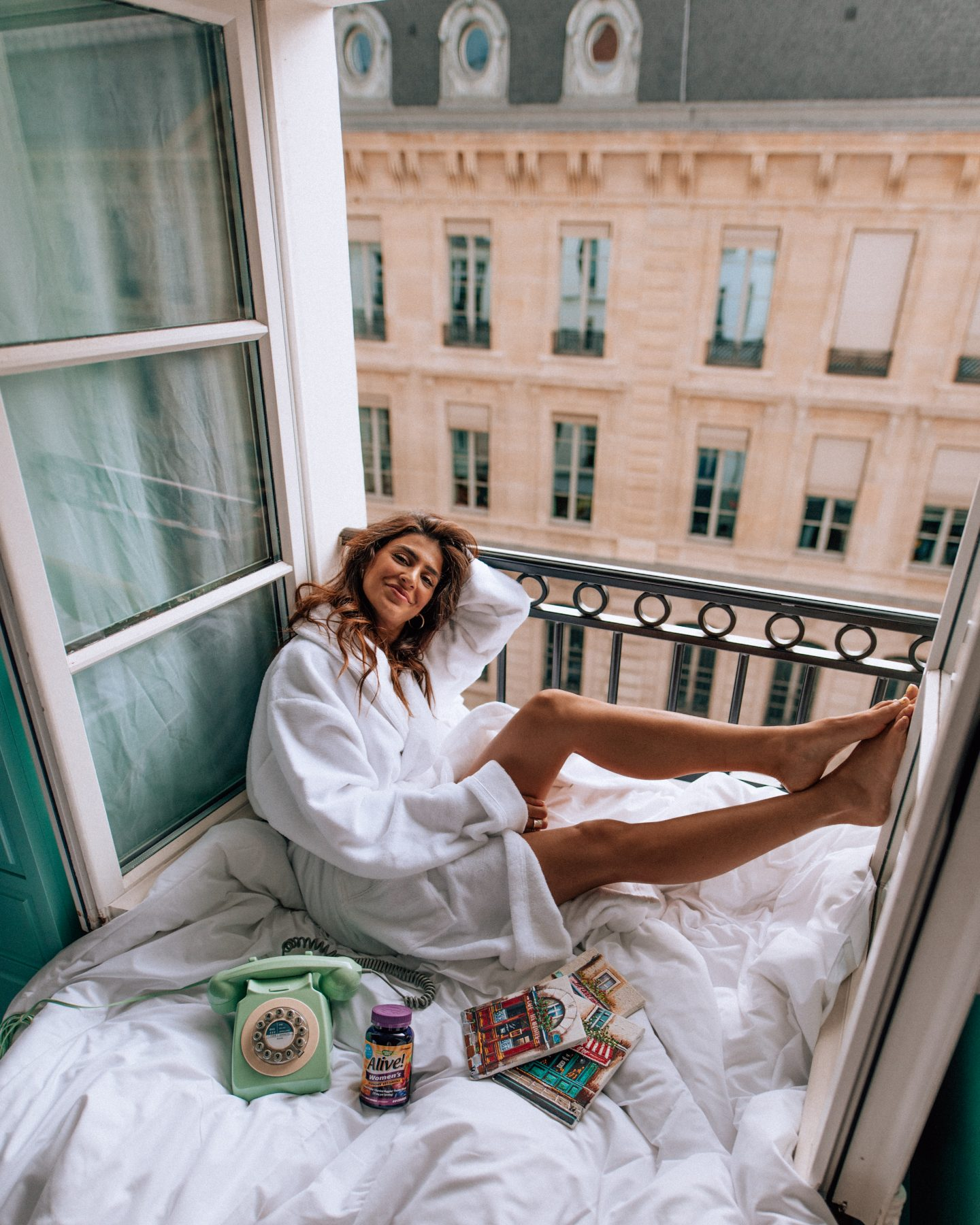 Lisa Homsy on a hotel balcony in Paris France