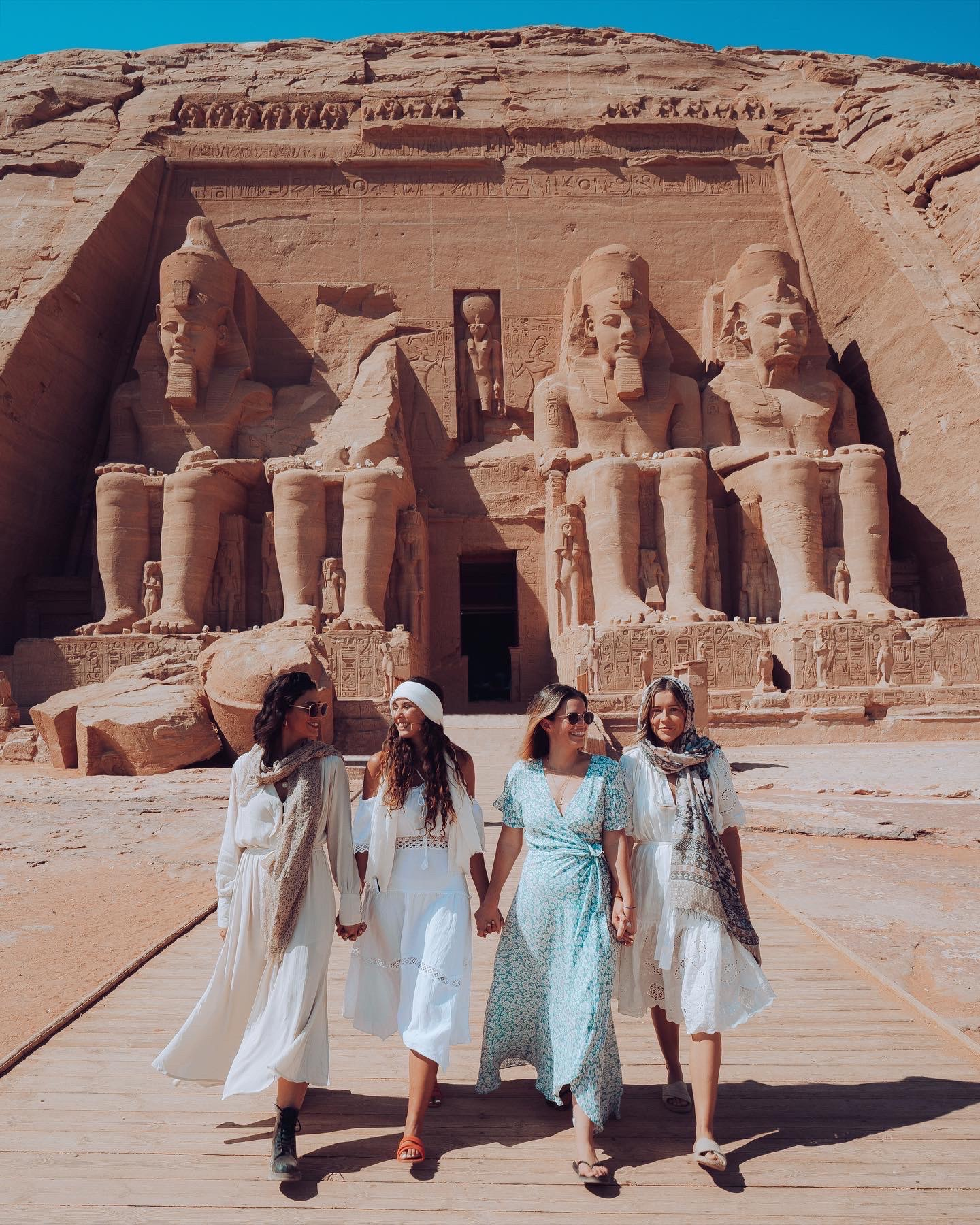 A group of women in Egypt in front of the Abu Simbel temple for Ramesses