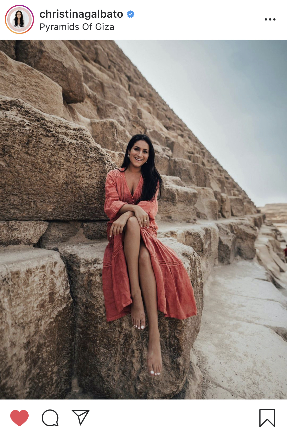 A woman sitting on the Great Pyramid of Giza