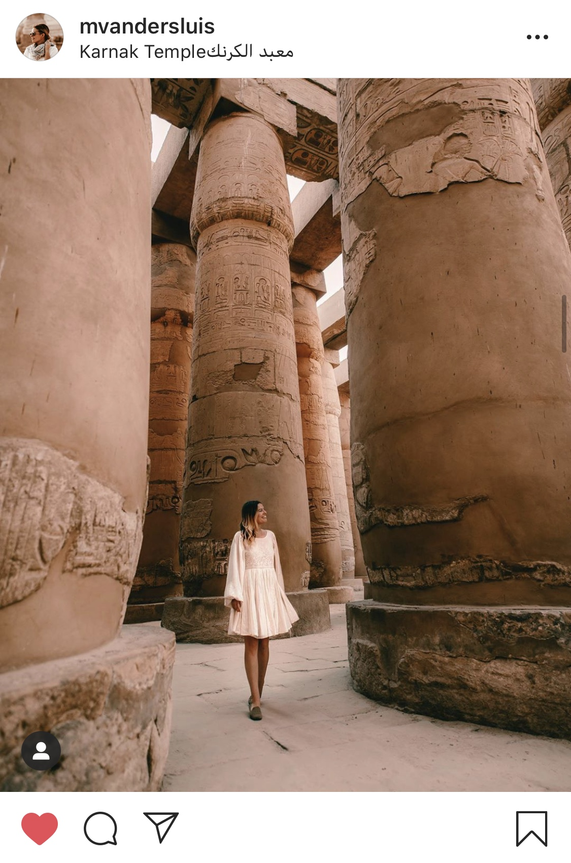 A woman walking through Karnak Temple in Luxor