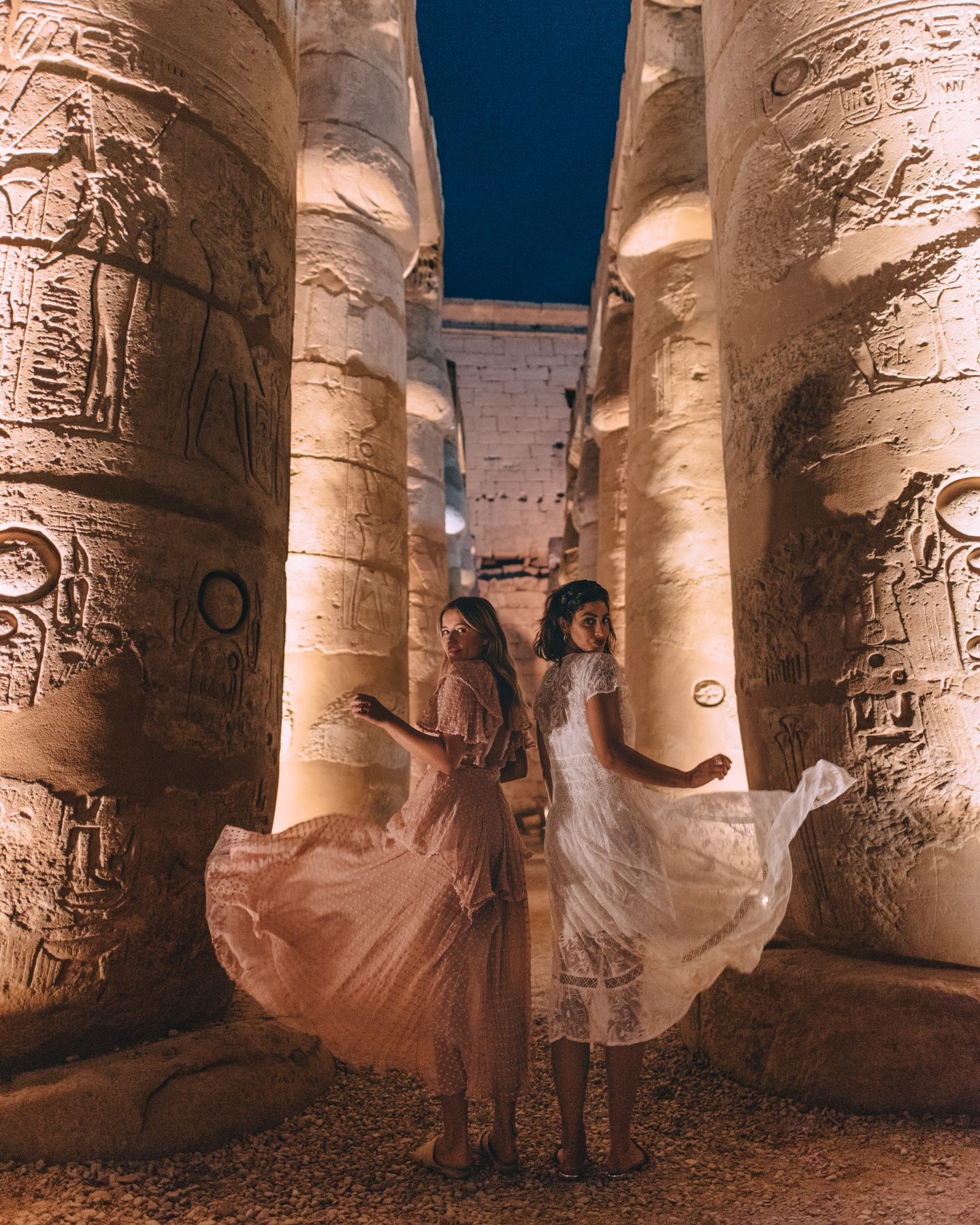 Two women in Luxor Temple at night in Luxor, Egypt