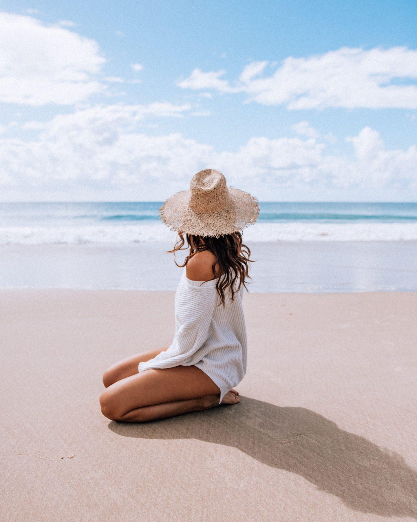 Woman posing on Byron Bay Beach in Australia