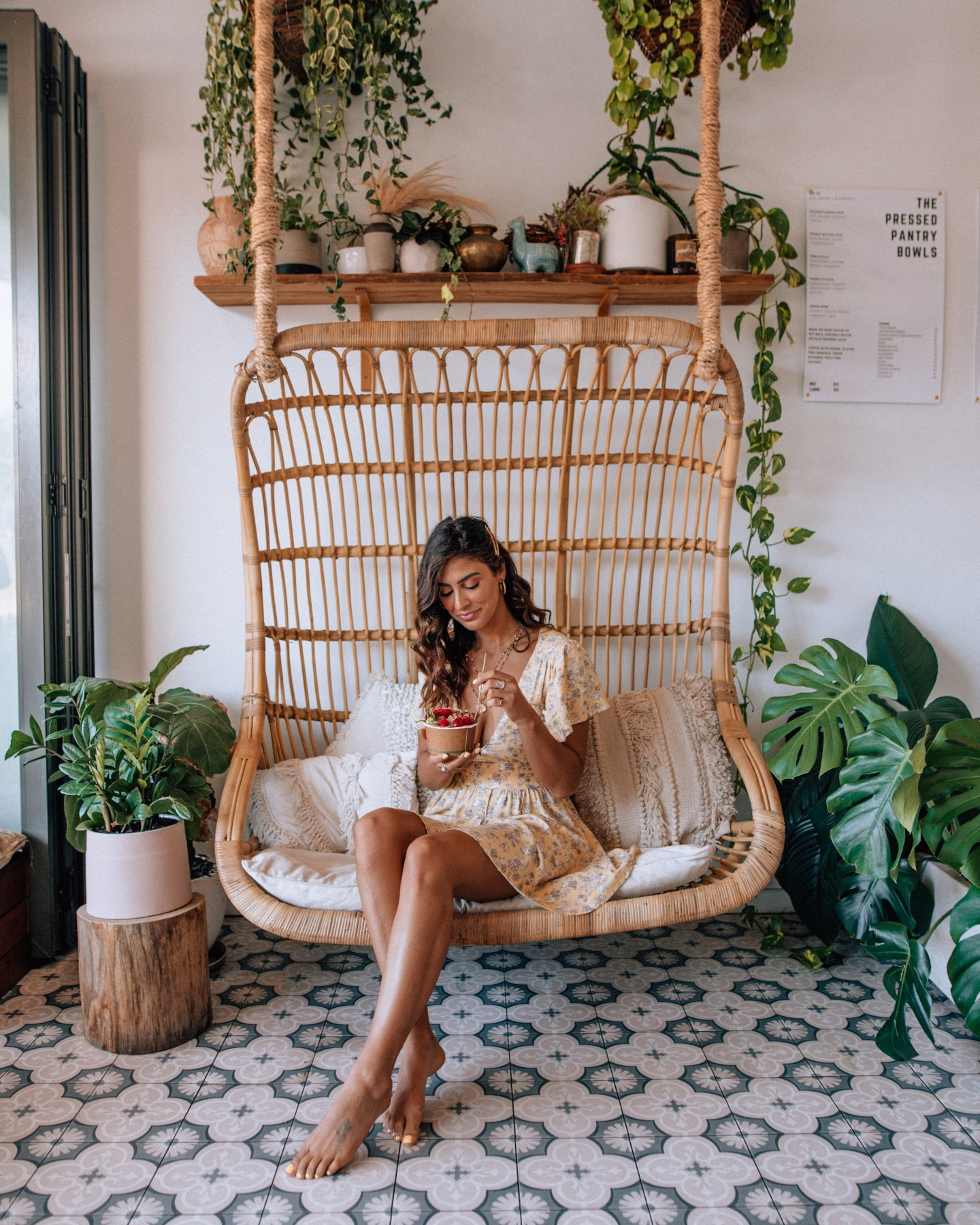 Woman eating at Pressed Pantry, a cafe in Byron Bay Australia