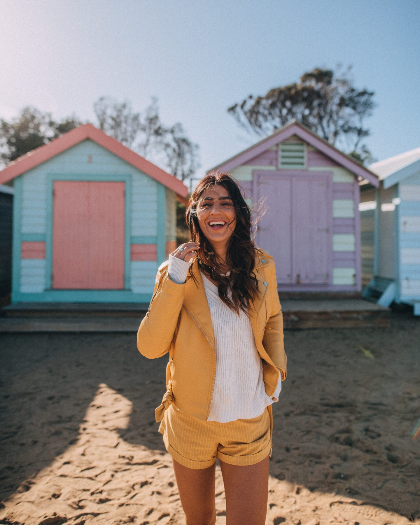Woman in front of the Brighton Bathing Boxes in Australia