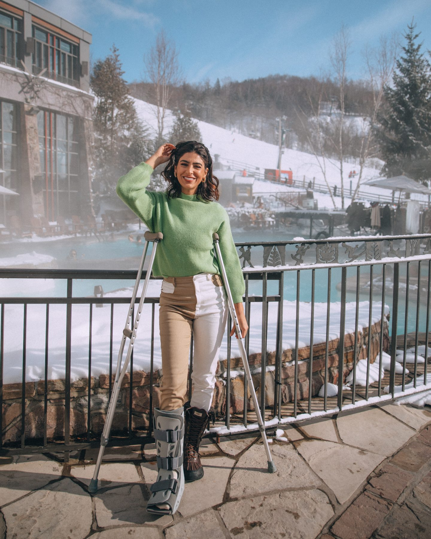Lisa Homsy working with brands and posing at a hotel in spite of a broken ankle