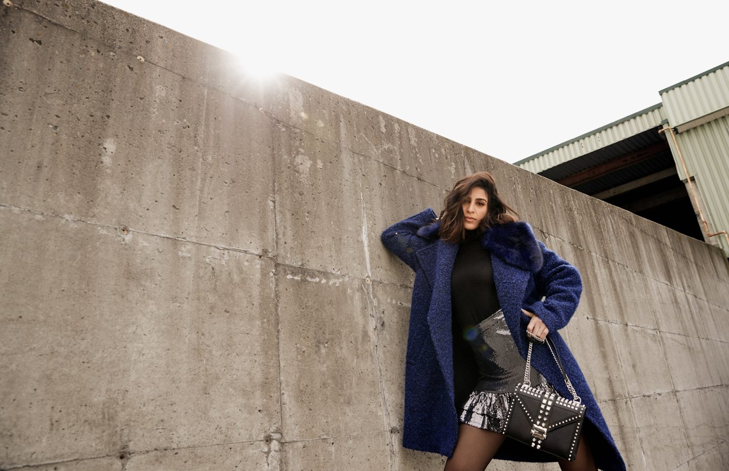 A woman wearing Michael Kors posing for a magazine photoshoot