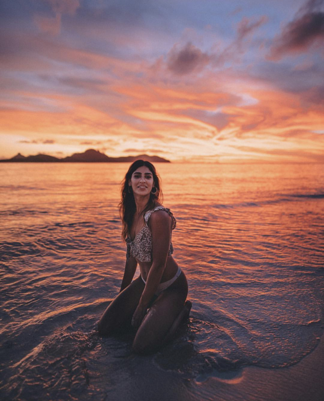 A woman posing on the beach at sunset in Fiji