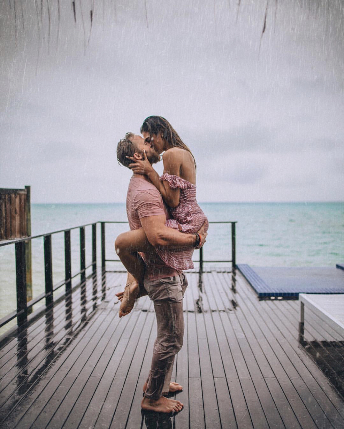 A couple poses like the famous scene in The Notebook in the Maldives