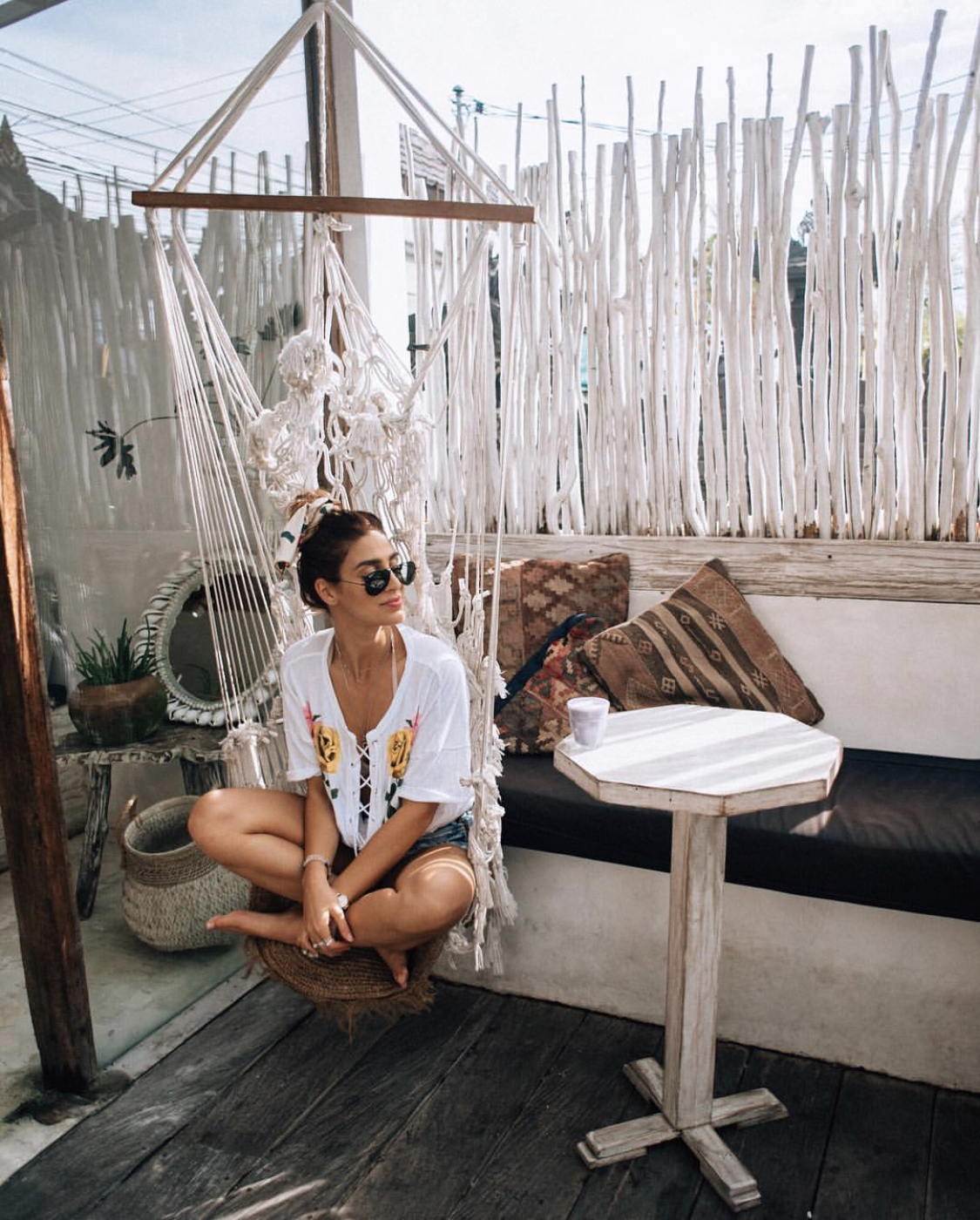 A woman in a swing at Cafe Organic in Canggu, Bali