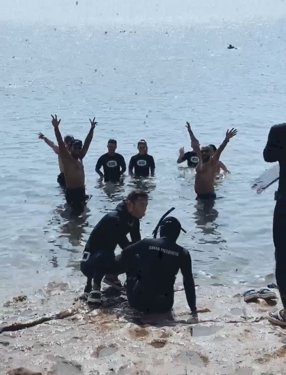 A group preparing to dive in the Red Sea in Dahab, Egypt