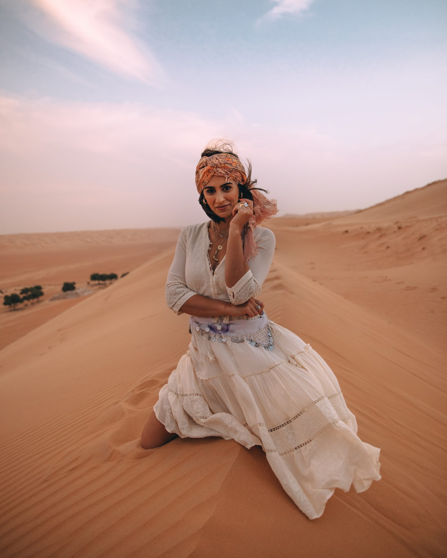 A woman posing in the desert in Oman - Wahiba Sands