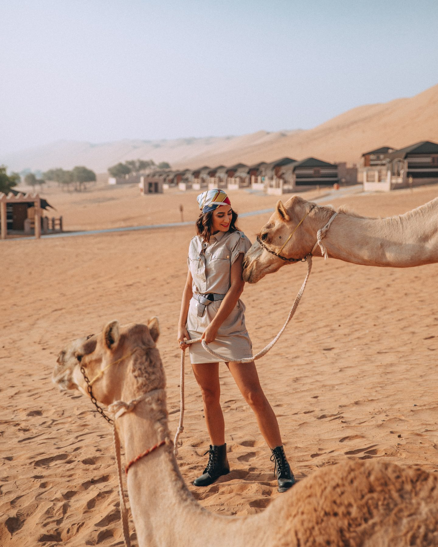 Lisa Homsy in Oman with a camel at 1000 Nights Camp
