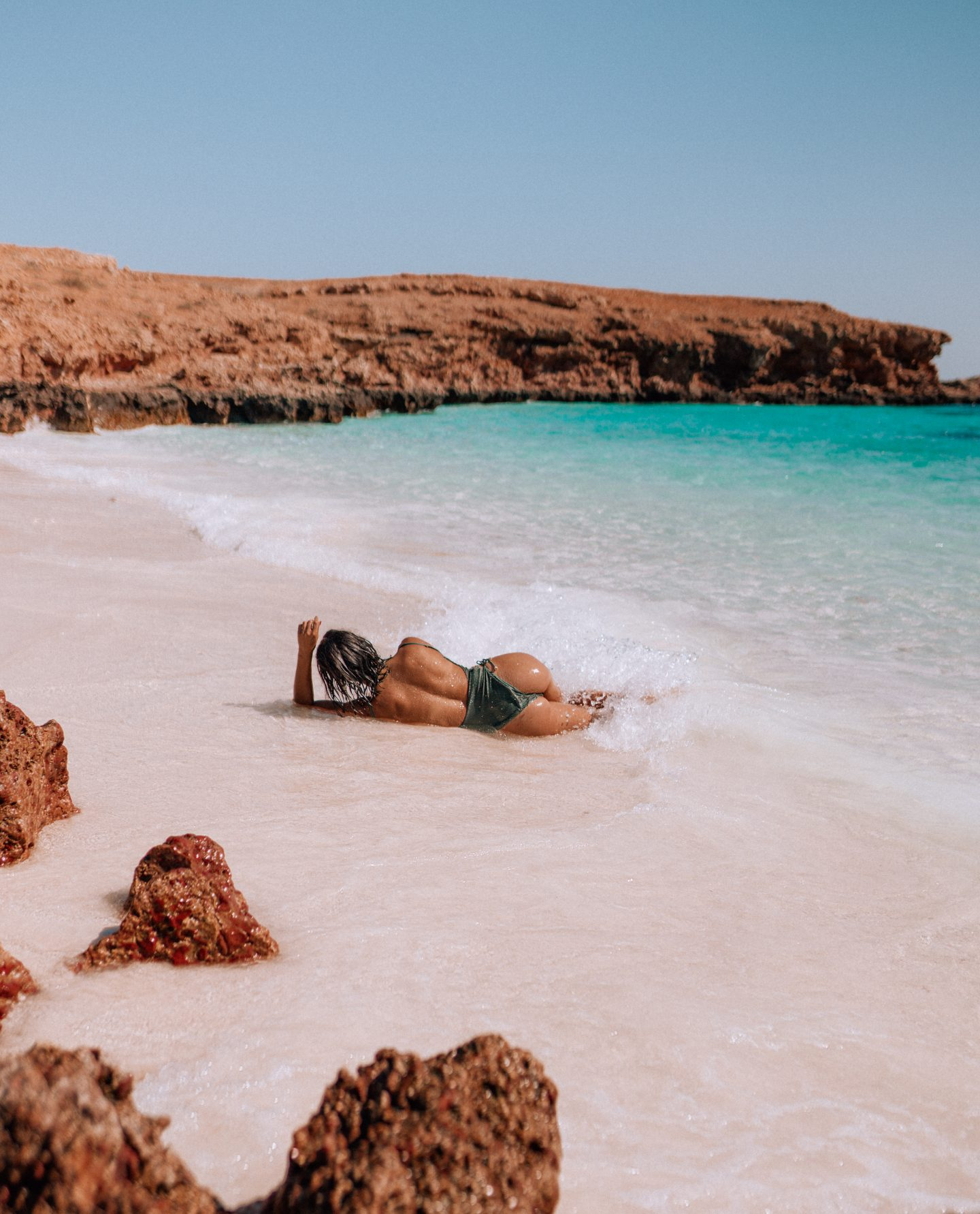 A woman on the beach in Oman at the Damaniyat Islands
