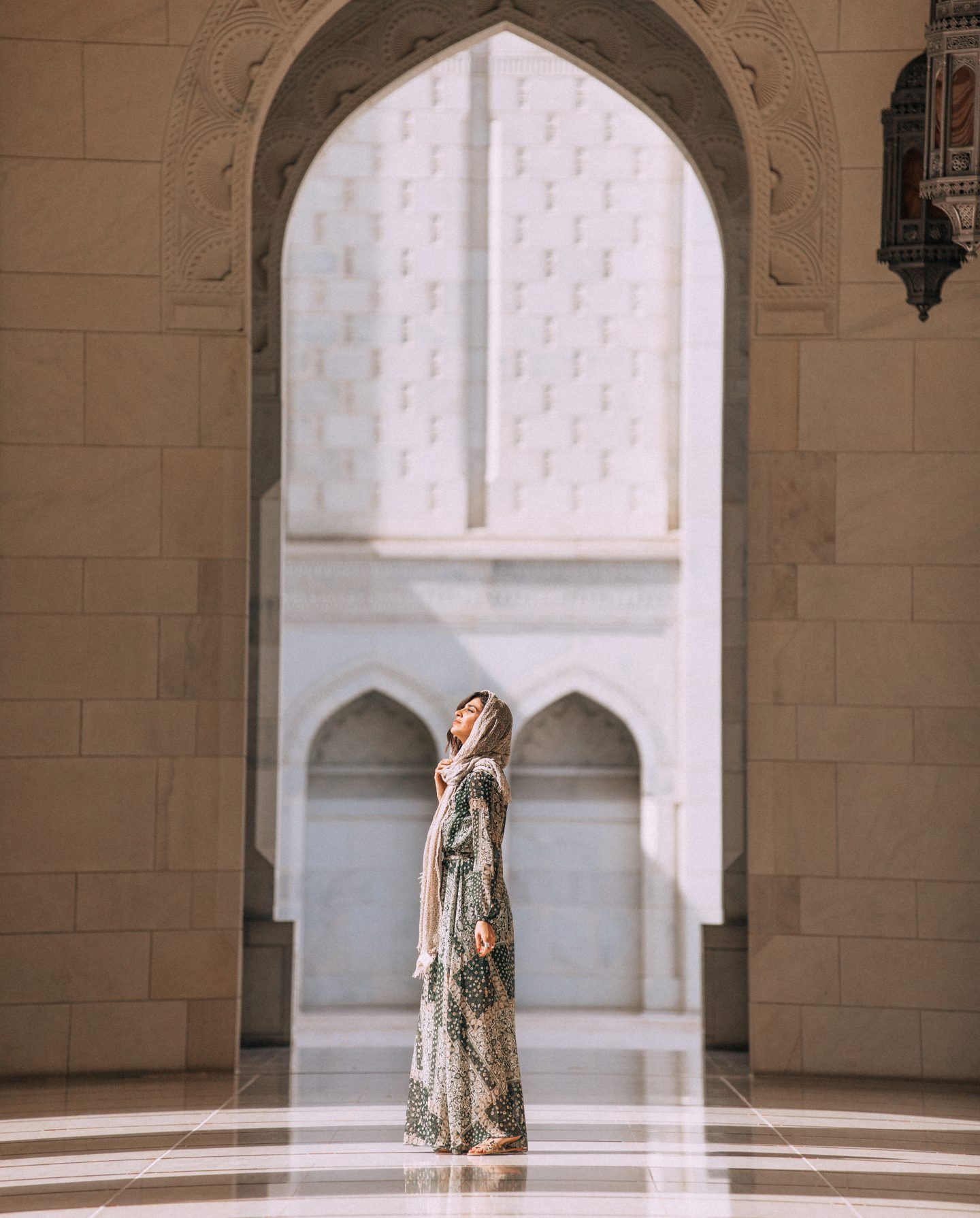 A woman in Sultan Qaboos Grand Mosque in Muscat, Oman