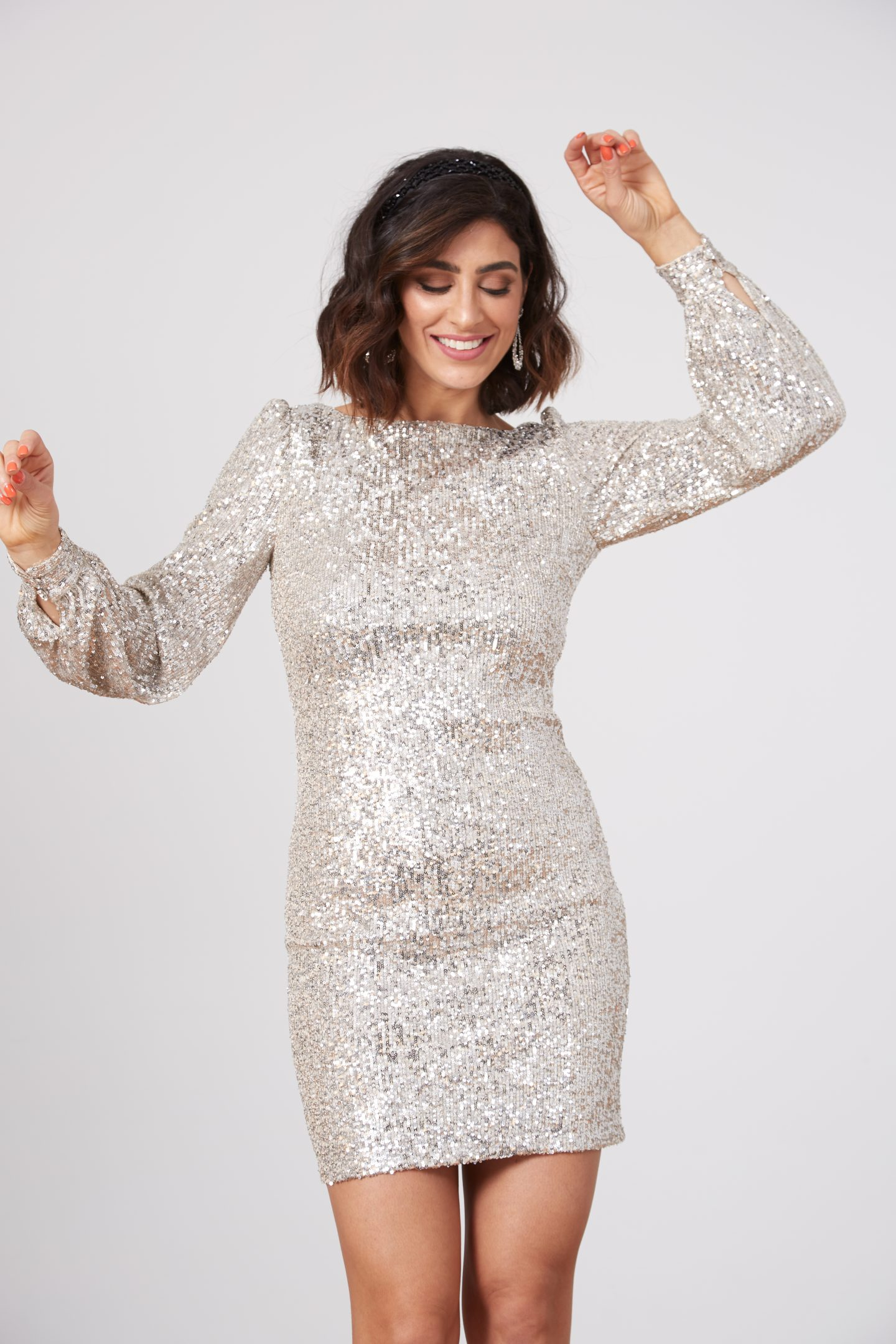 Lisa Homsy wearing a sequined silver dress perfect for New Year's Eve
