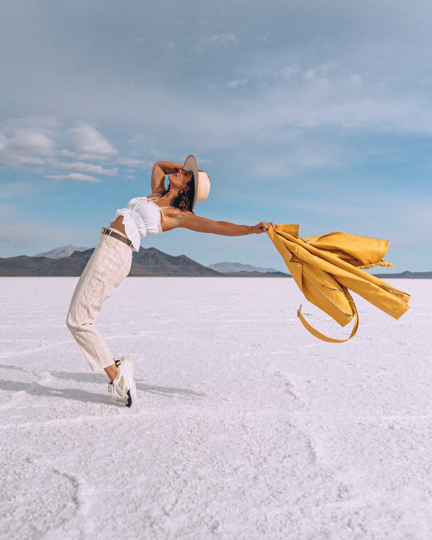 Woman posing for a Bonneville Salt Flats photo shoot outside of Salt Lake City