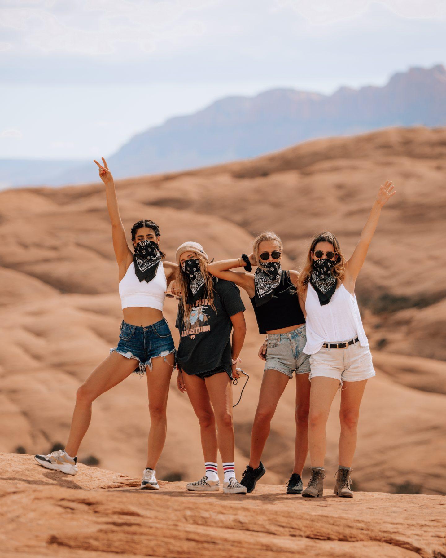 Four women at Hell's Revenge off road trail in Moab, Utah