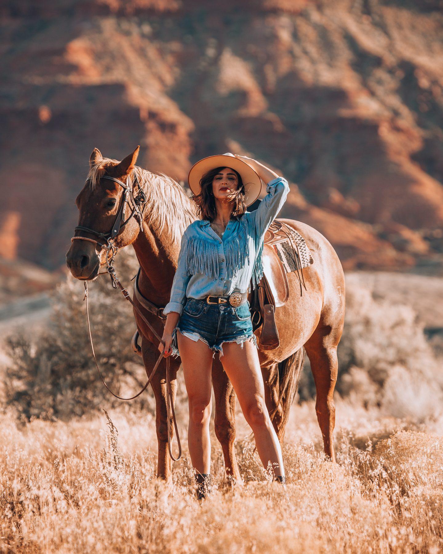 Photoshoot in Moab, Utah while on a sunset horseback ride