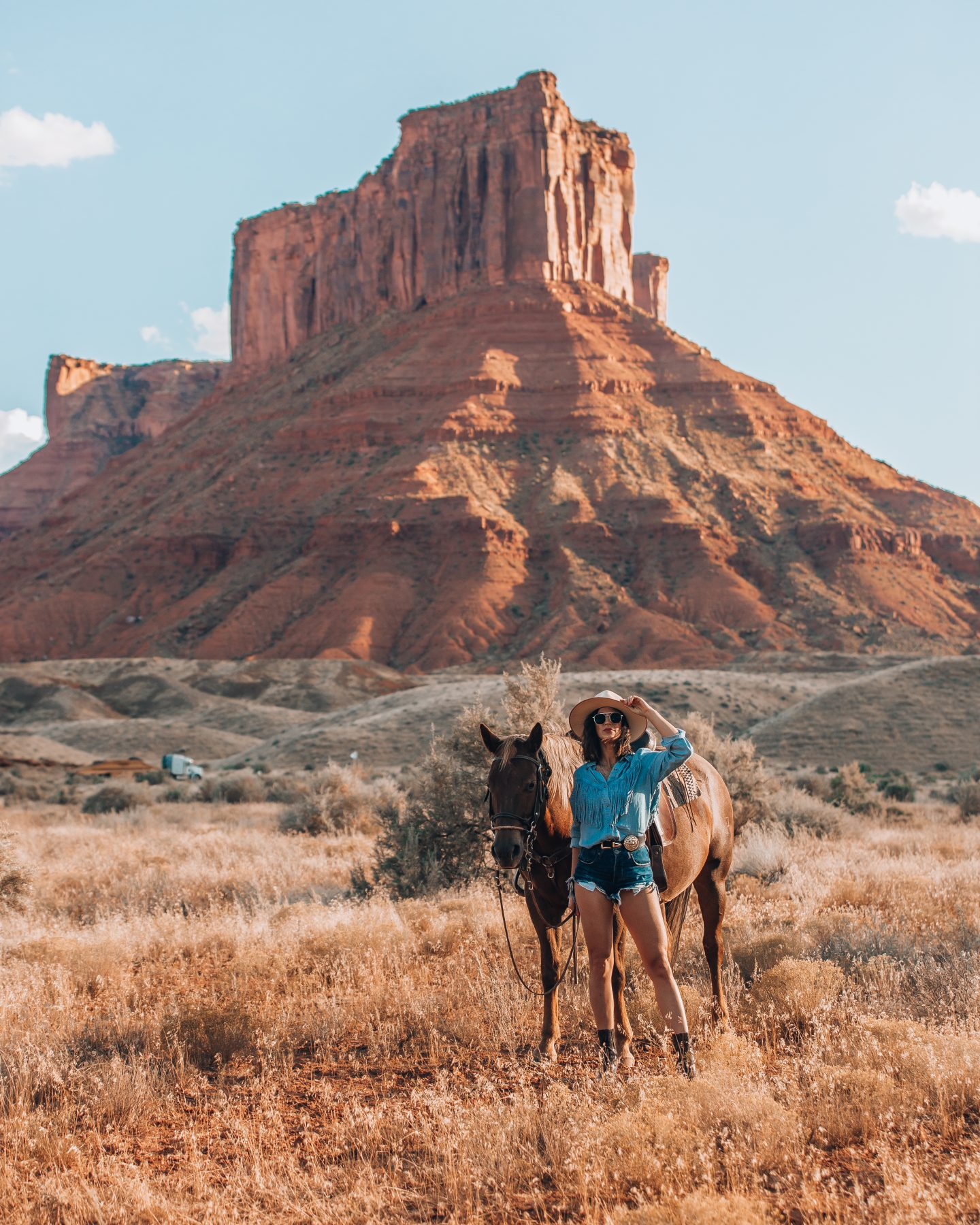Woman with a horse outside of Moab Utah
