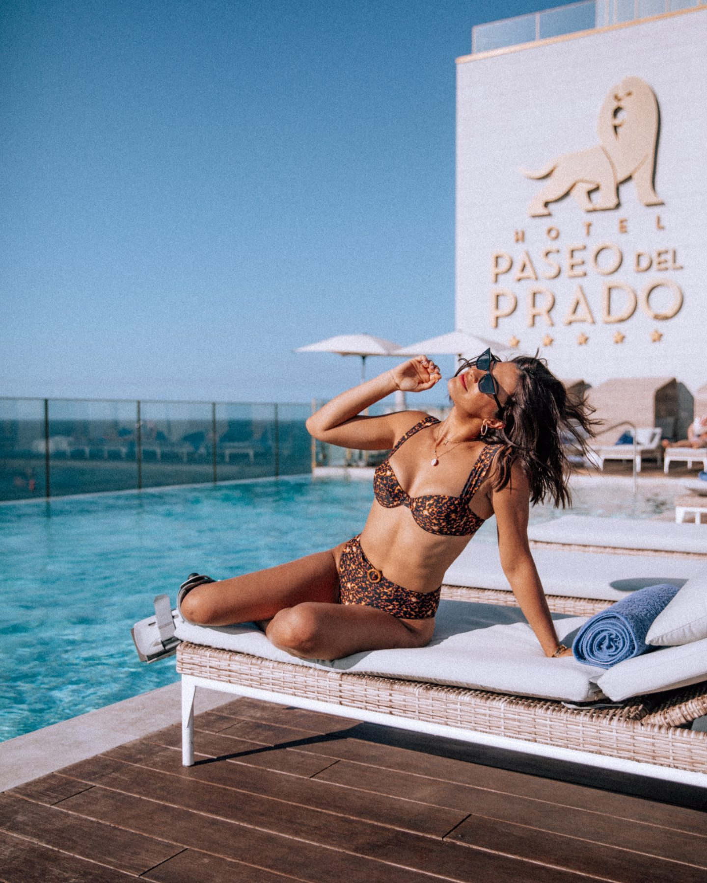 Lisa Homsy in Cuba with a broken ankle posing by the pool for an Instagram picture idea