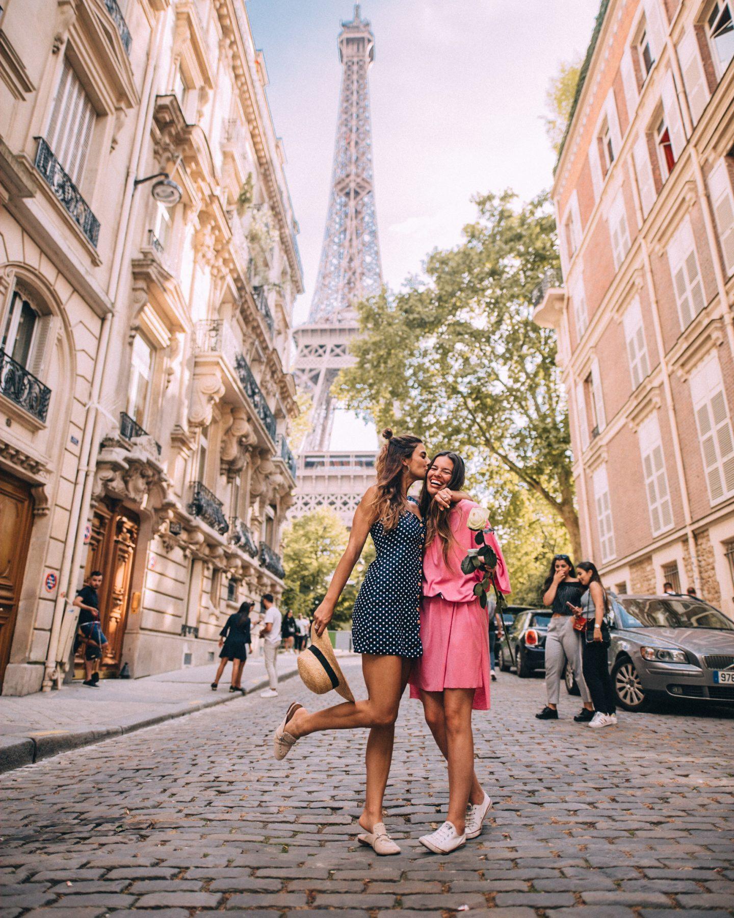 Lisa Homsy and Mel Vandersluis in Paris at the Eiffel Tower