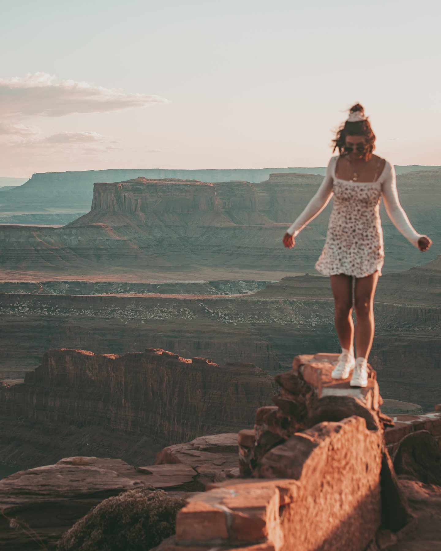 Woman standing on the edge of Dead Horse Canyon in Utah