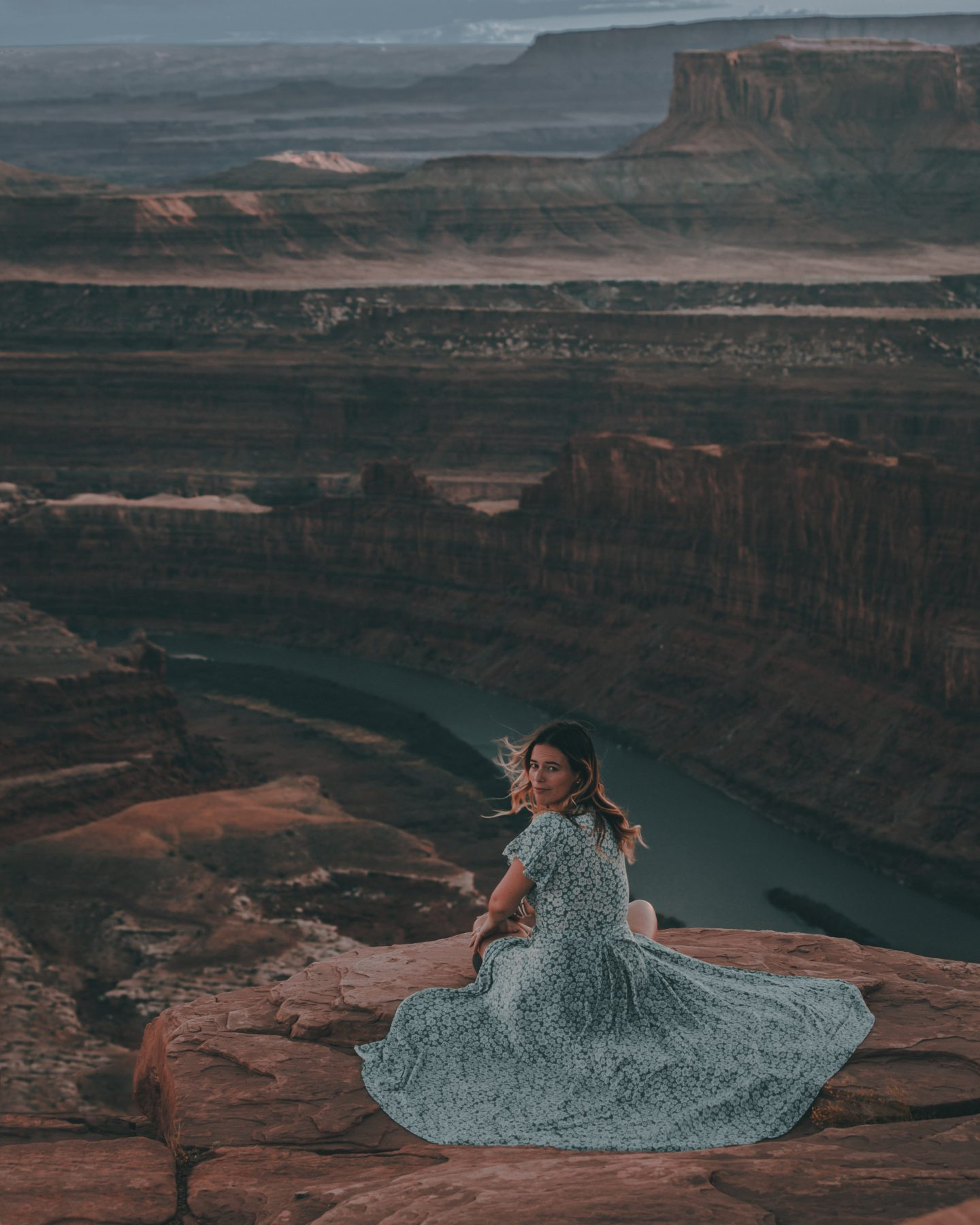 Woman sitting on the edge of Dead Horse Point in Utah