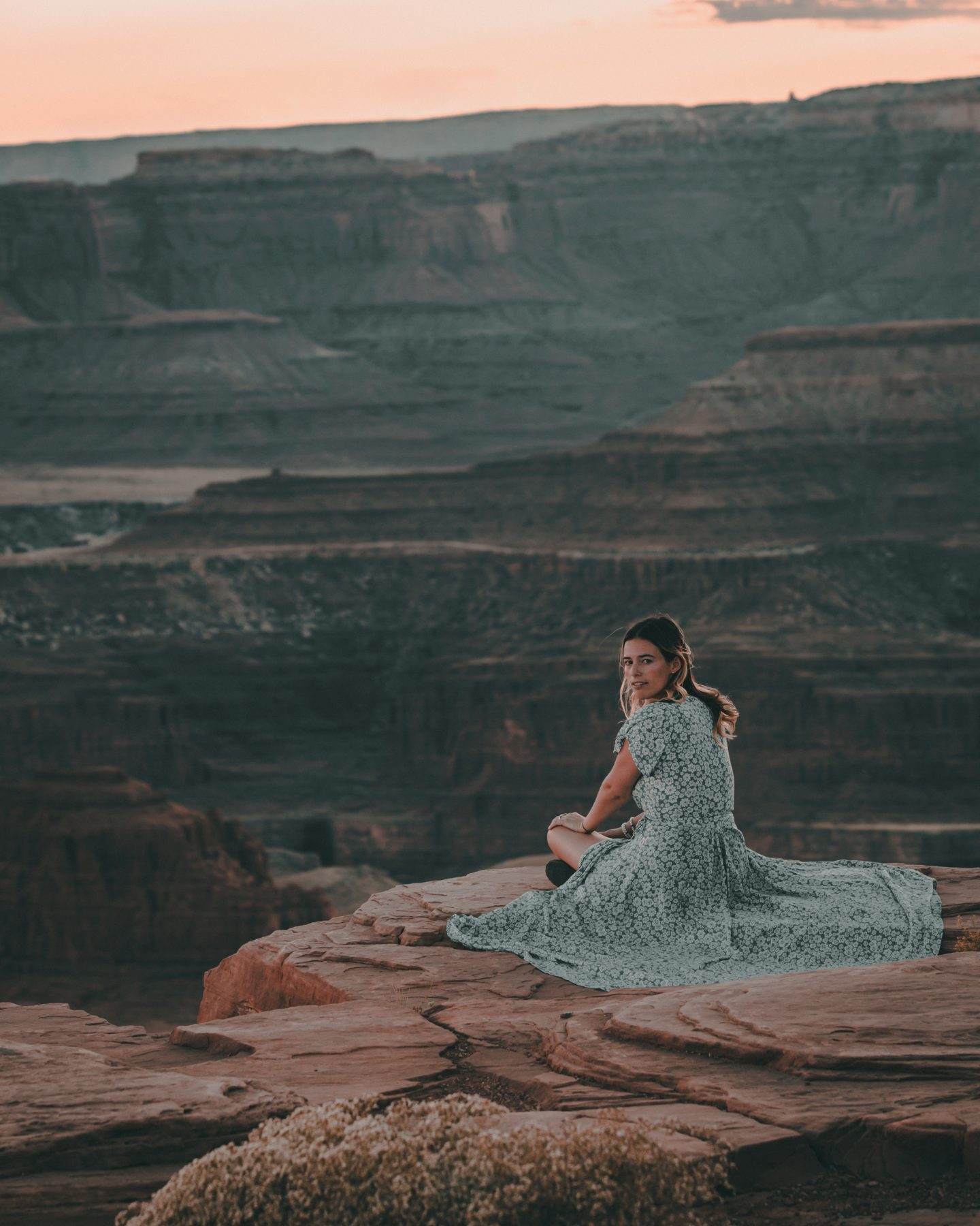 Woman sitting on the edge of Dead Horse Point